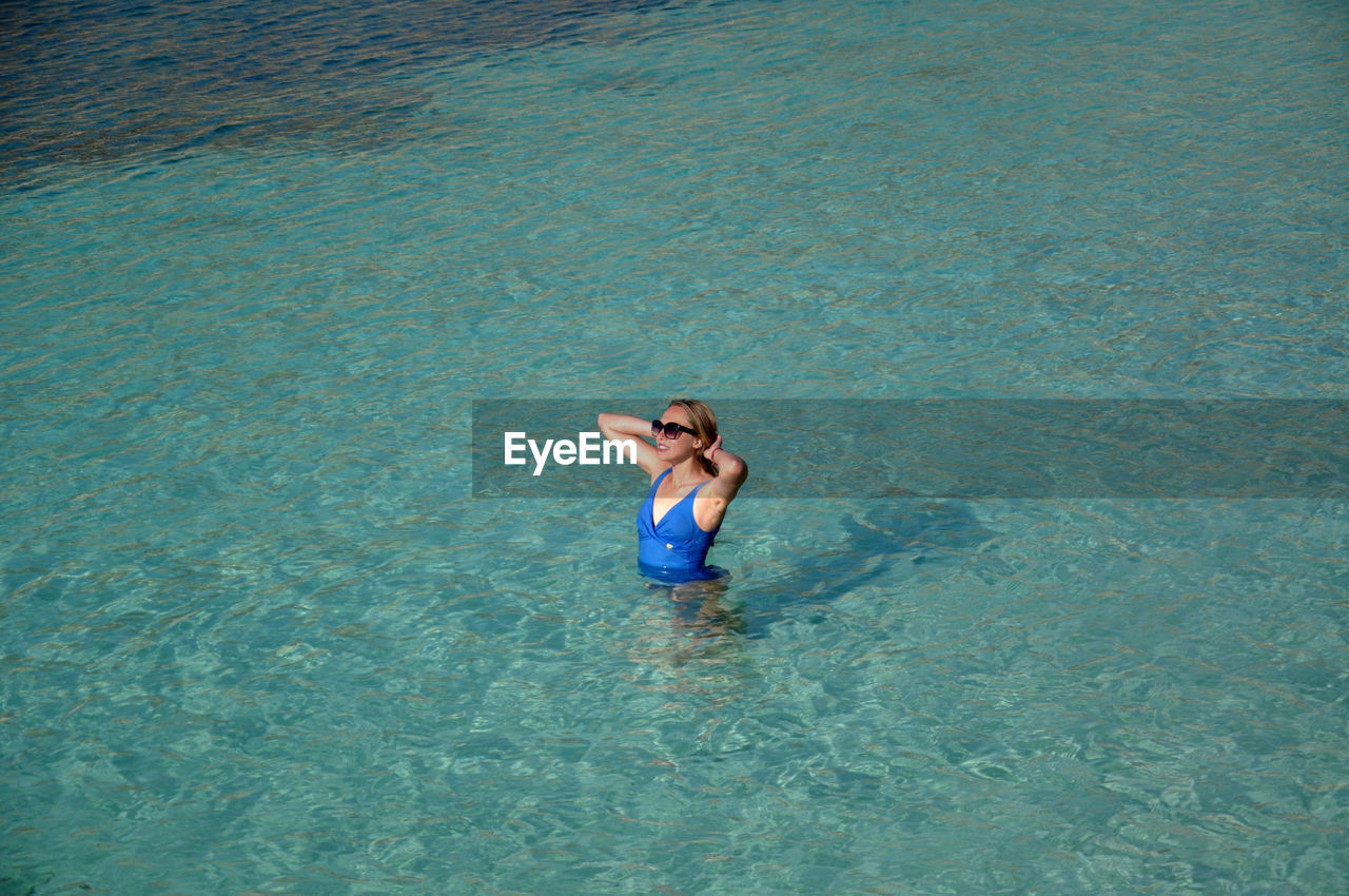 High Angle View Of Young Woman In Sea
