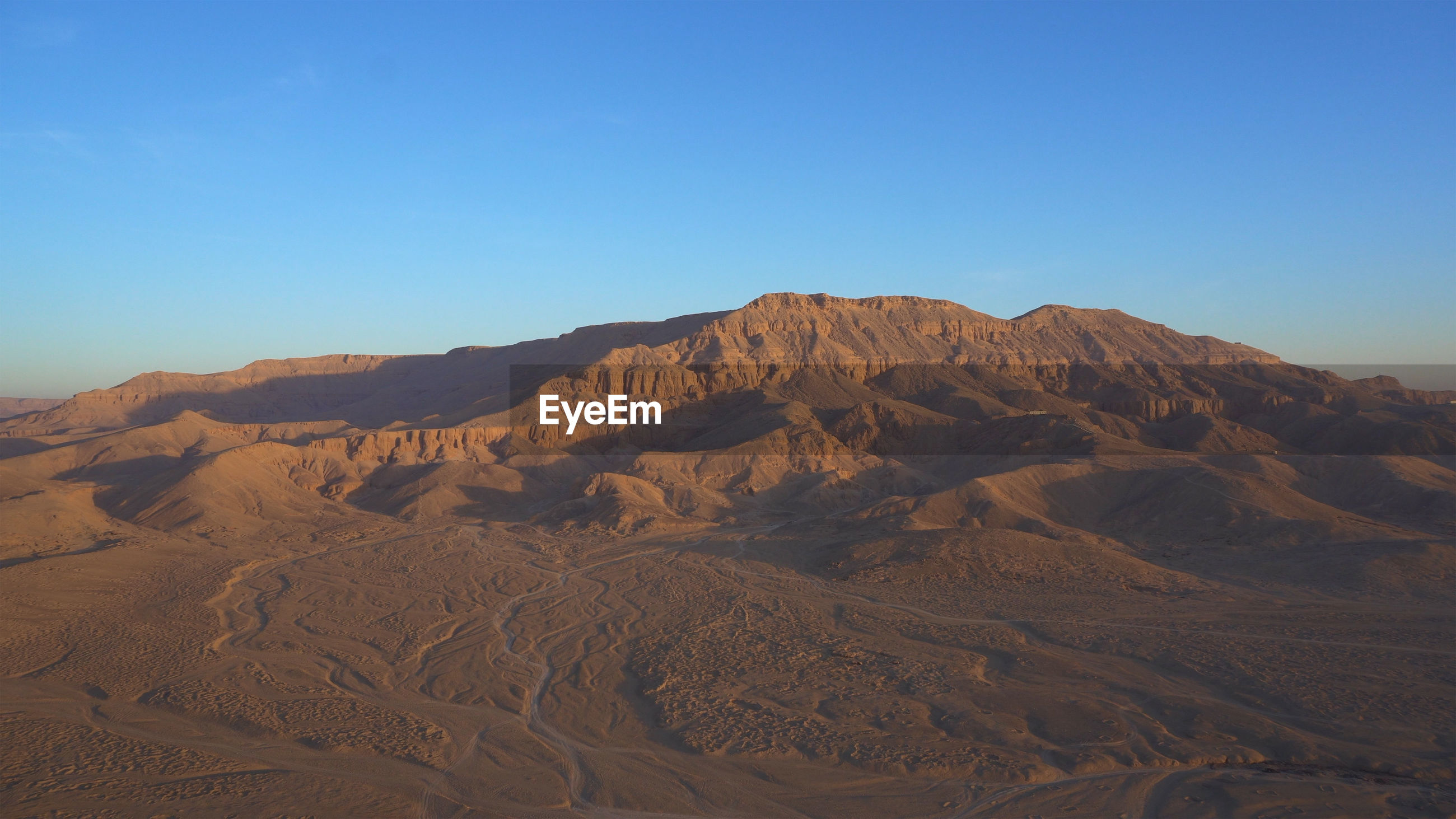 Luxor egypt panorama view riding hot air balloon over valley of the king sunrise aerial view video