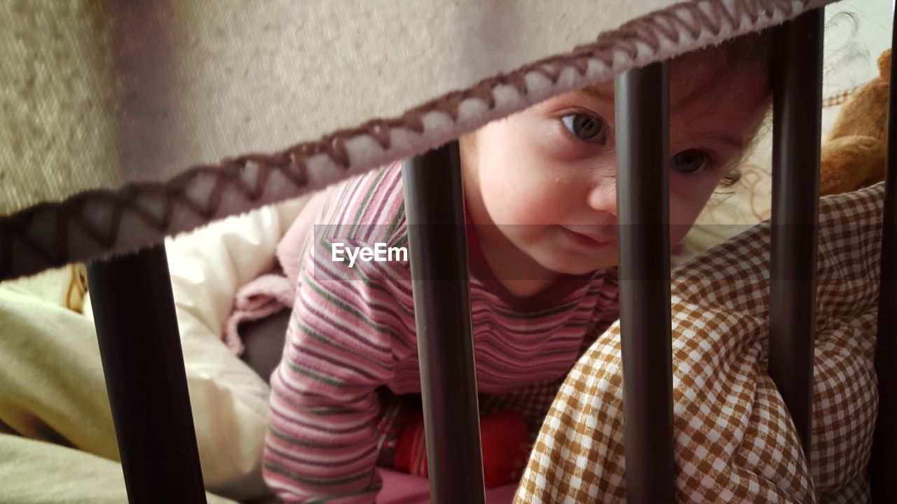 Toddler looking away while resting in crib