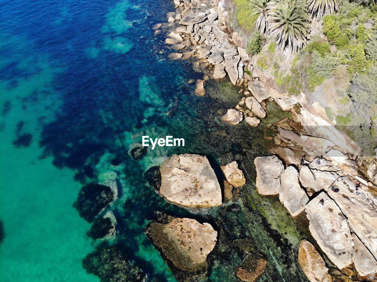 water, solid, rock, rock - object, beauty in nature, nature, high angle view, sea, no people, day, tranquility, scenics - nature, rock formation, transparent, underwater, outdoors, land, tranquil scene, idyllic, turquoise colored, purity, shallow