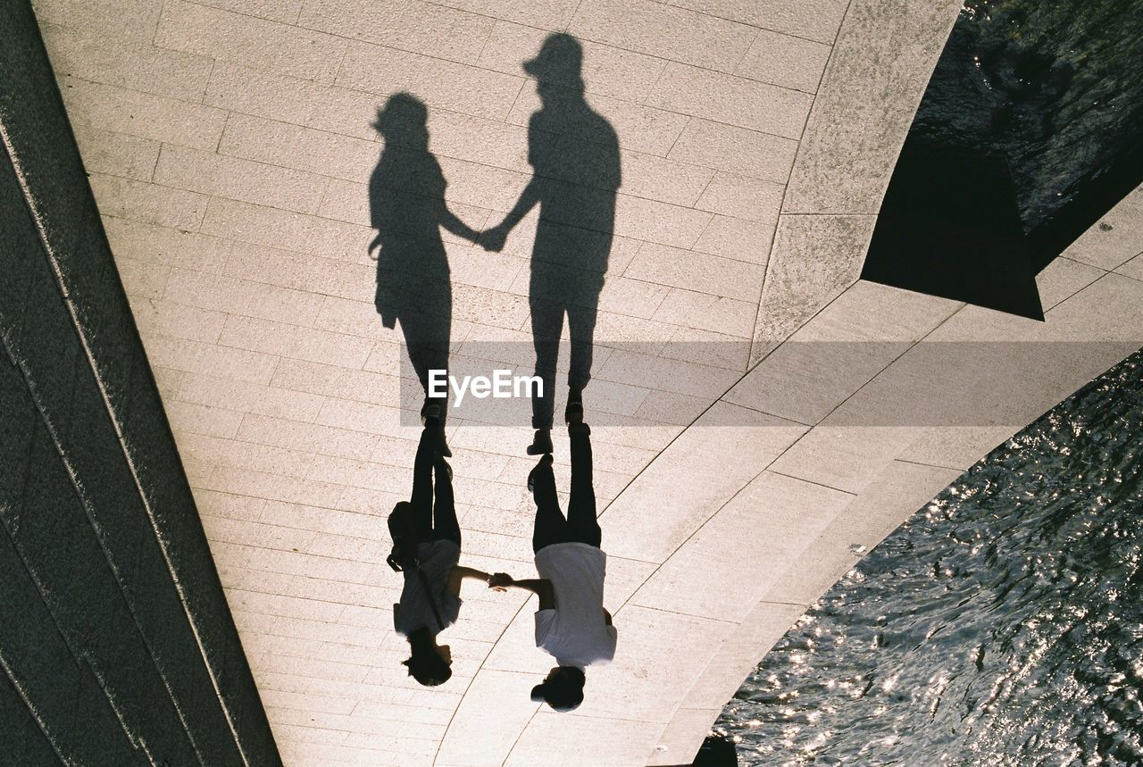 Upside down image of couple standing on promenade