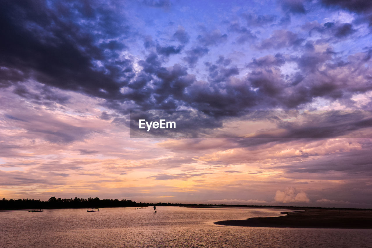 sky, cloud - sky, sunset, beauty in nature, scenics - nature, water, tranquility, sea, tranquil scene, land, nature, orange color, beach, idyllic, no people, outdoors, sand, non-urban scene, dramatic sky