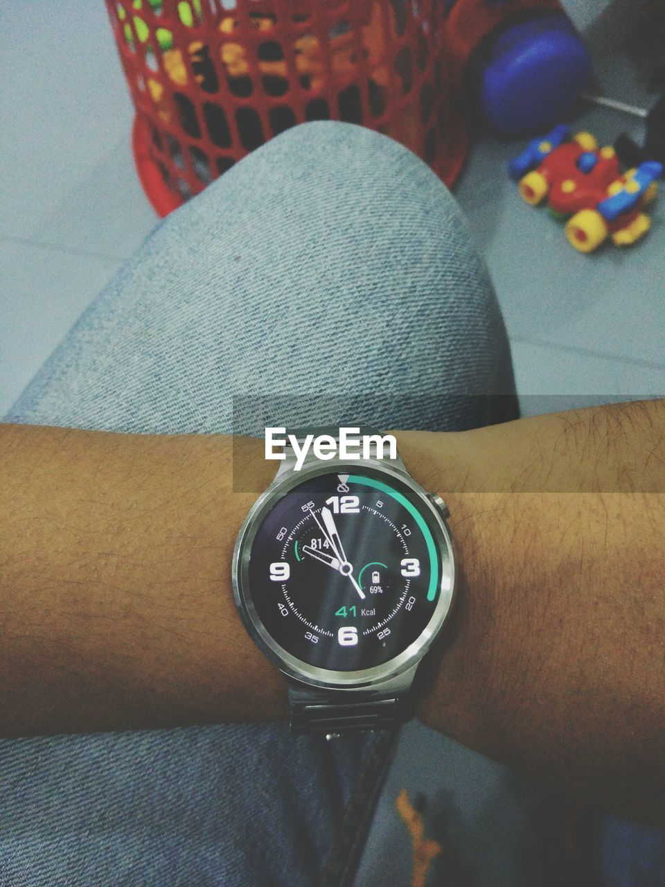 Midsection of man wearing wristwatch at home