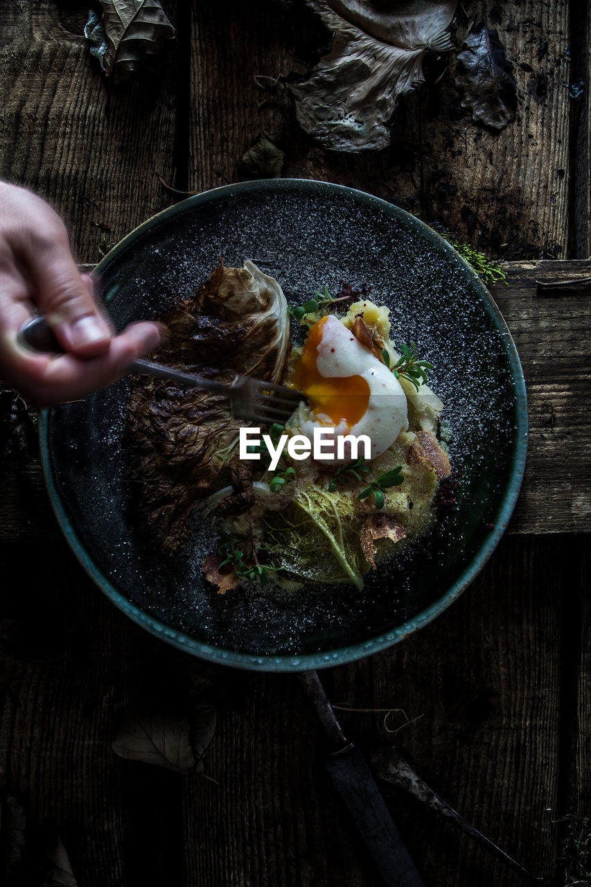 Food Food And Drink Human Hand Freshness Hand One Person Human Body Part Wood - Material Egg Indoors  Real People Table Directly Above Healthy Eating Holding Kitchen Utensil Bowl High Angle View Wellbeing Egg Yolk Finger Fried Egg Breakfast Preparing Food