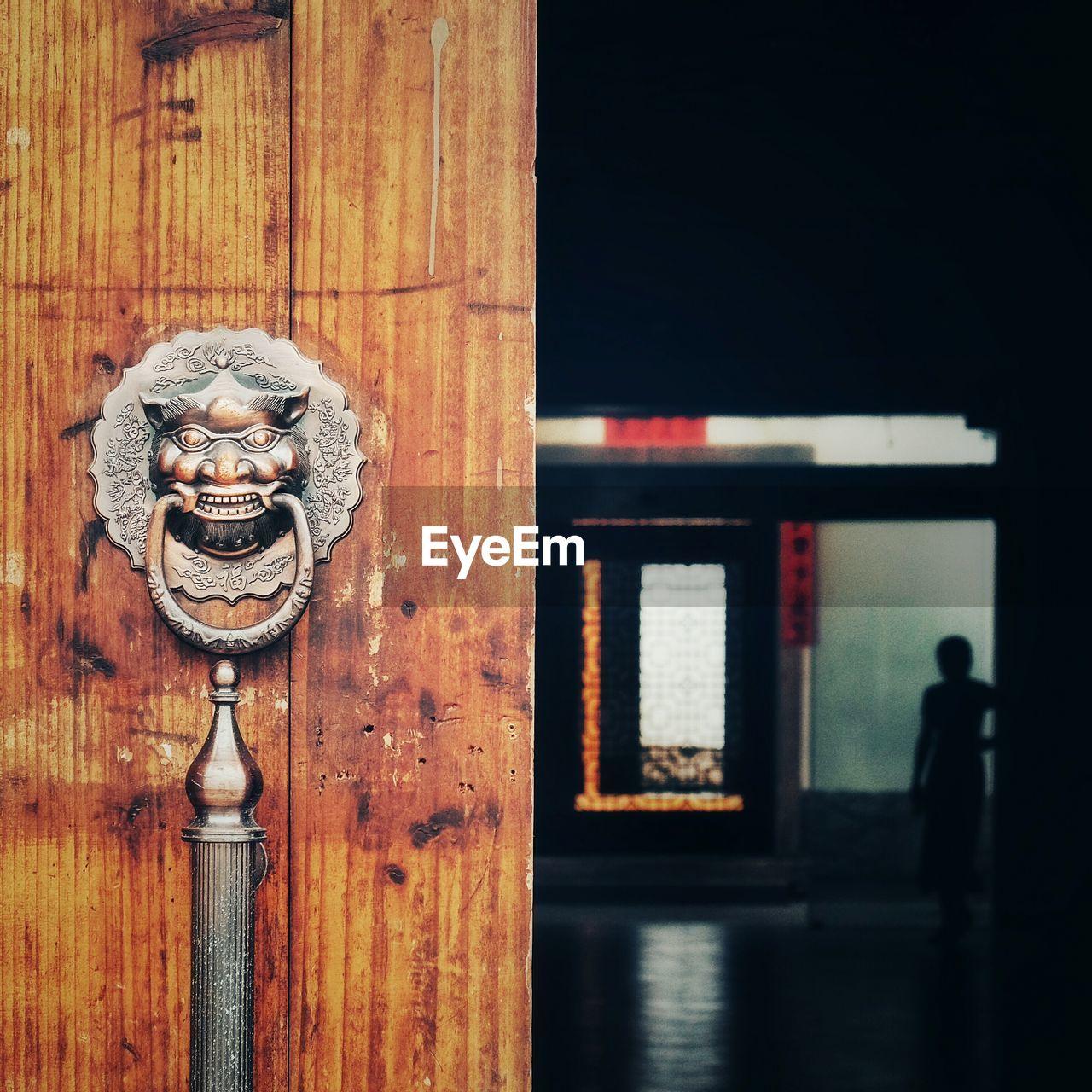 Old Antique Knocker And Handle On Wooden Door