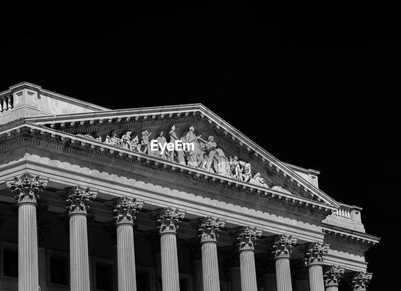 architecture, building exterior, built structure, architectural column, travel destinations, low angle view, history, outdoors, pediment, facade, night, no people, city, sky