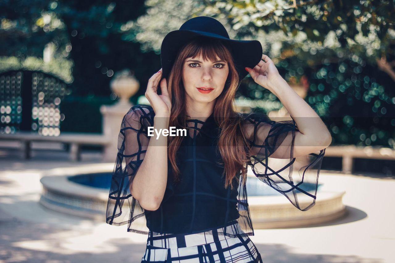 Portrait of beautiful woman wearing sun hat