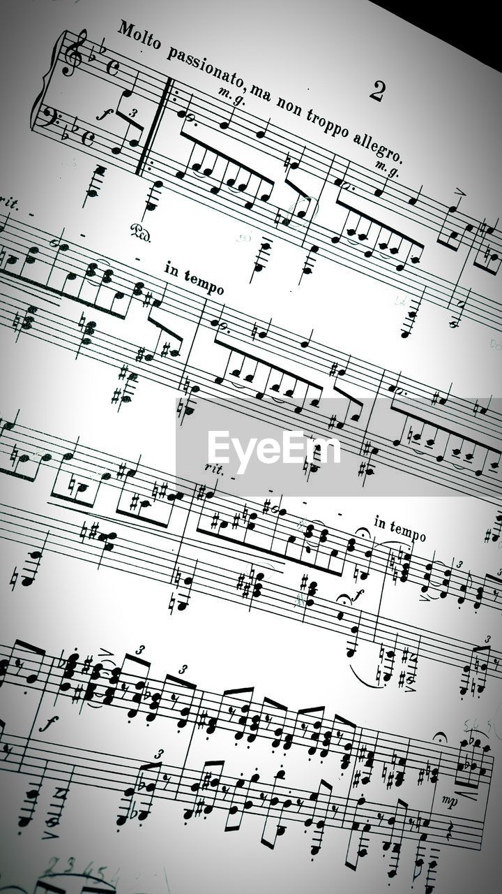 High Angle View Of Sheet Music With Notes