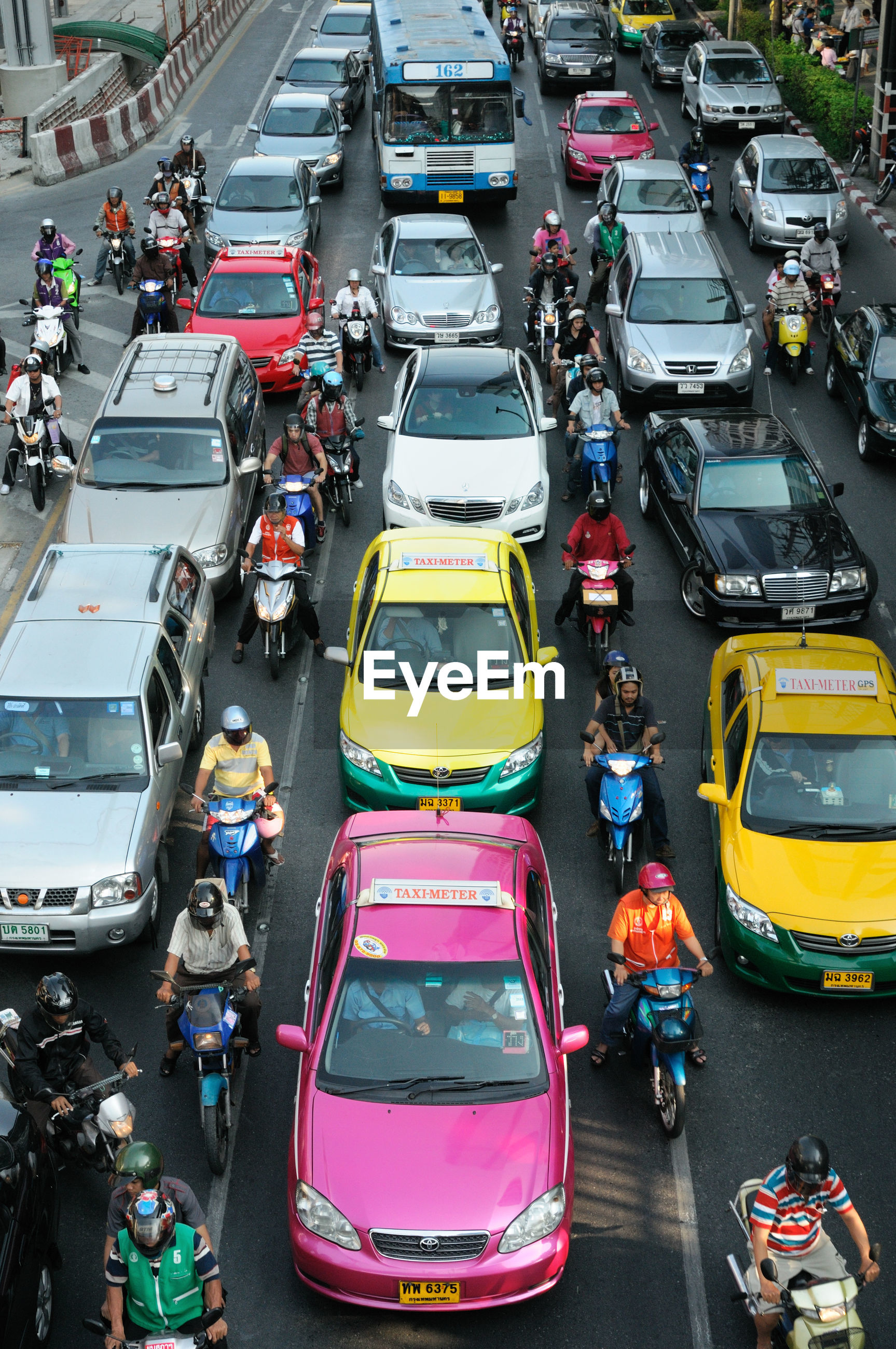 High angle view of cars and motor scooters on street