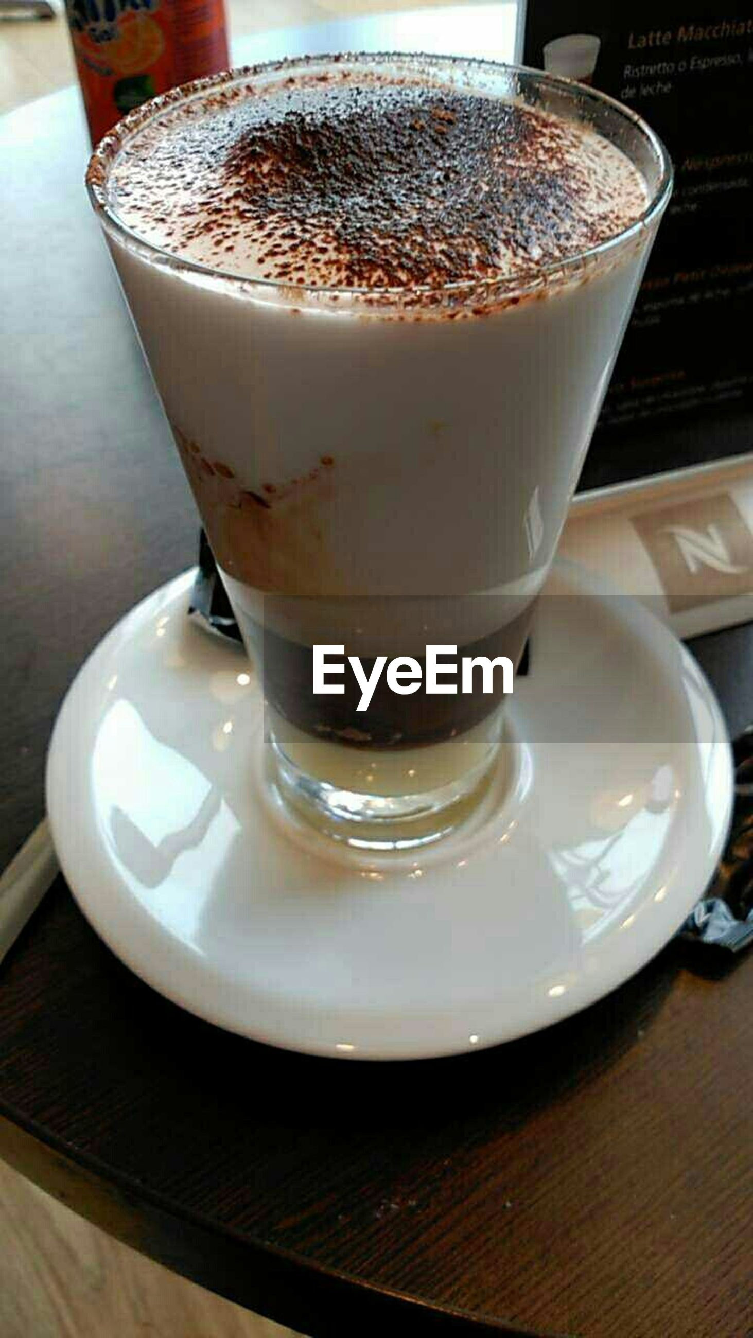 drink, food and drink, refreshment, indoors, table, coffee cup, frothy drink, coffee - drink, freshness, saucer, still life, close-up, coffee, drinking glass, cappuccino, cup, froth art, high angle view, cafe, spoon