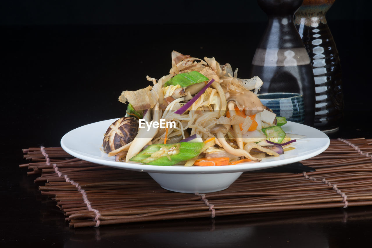 food and drink, food, table, plate, no people, freshness, indoors, healthy eating, ready-to-eat, bowl, serving size, black background, close-up, day