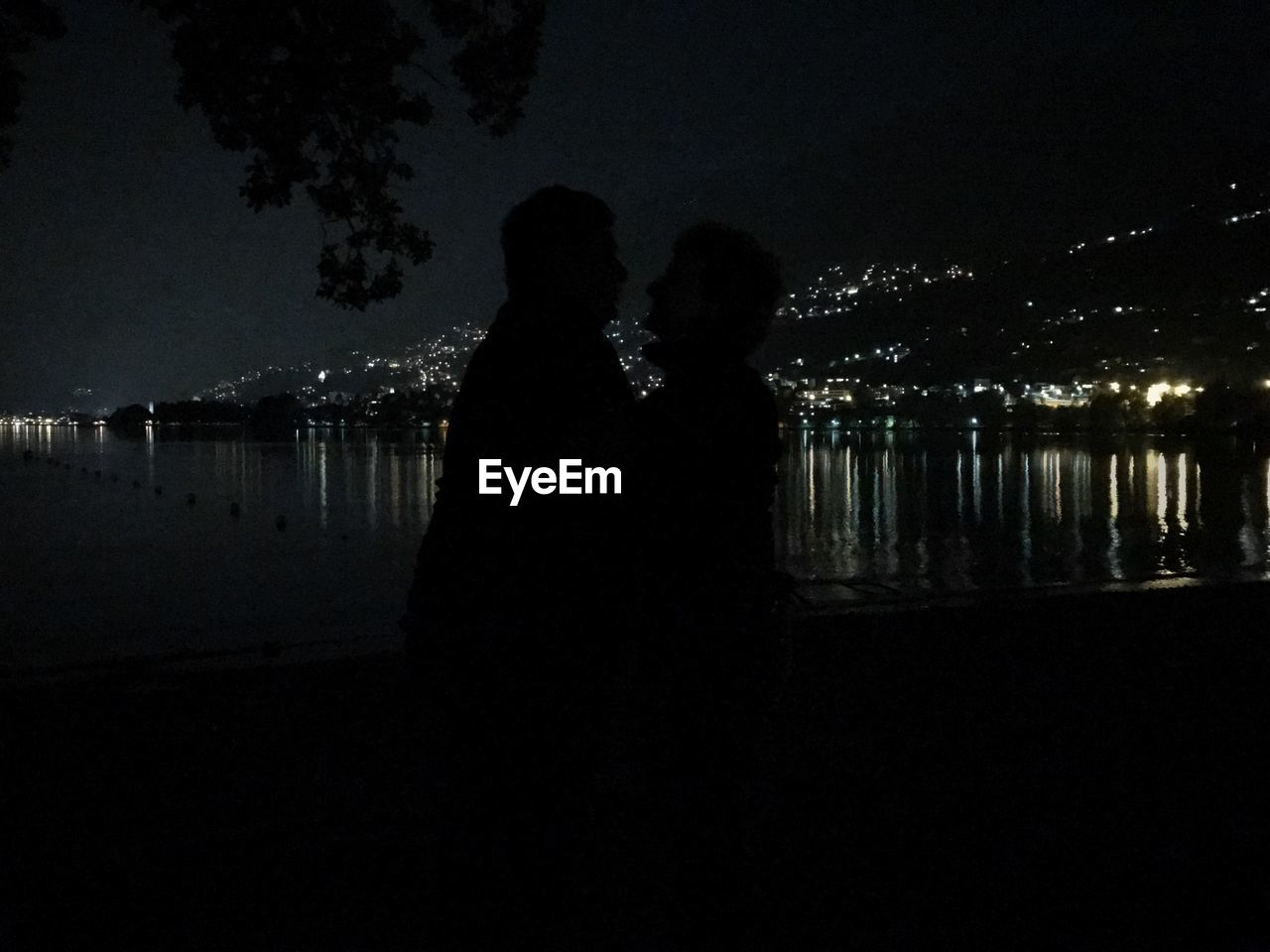 two people, night, water, togetherness, real people, sky, love, illuminated, silhouette, nature, men, women, couple - relationship, leisure activity, standing, positive emotion, bonding, adult, lifestyles, outdoors, dark