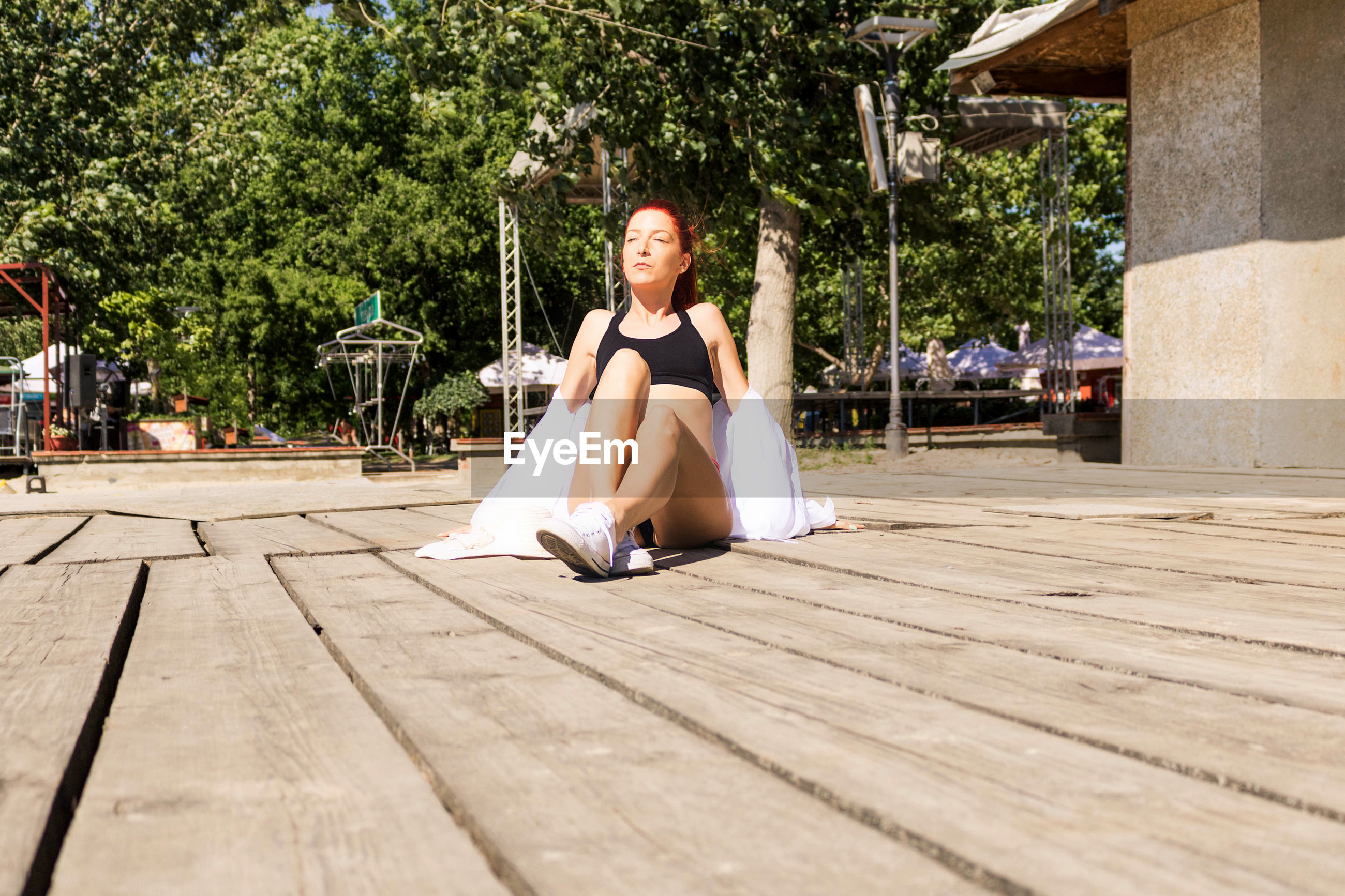 Young redhead woman sunbathing during summer vacation.