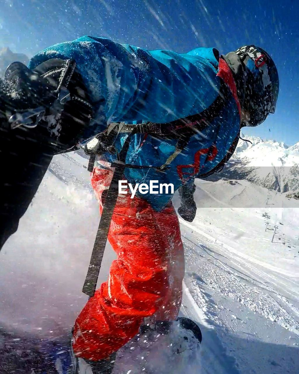 winter, cold temperature, nature, snow, day, one person, mountain, water, sport, outdoors, clothing, unrecognizable person, scenics - nature, reflection, sky, red, blue, warm clothing