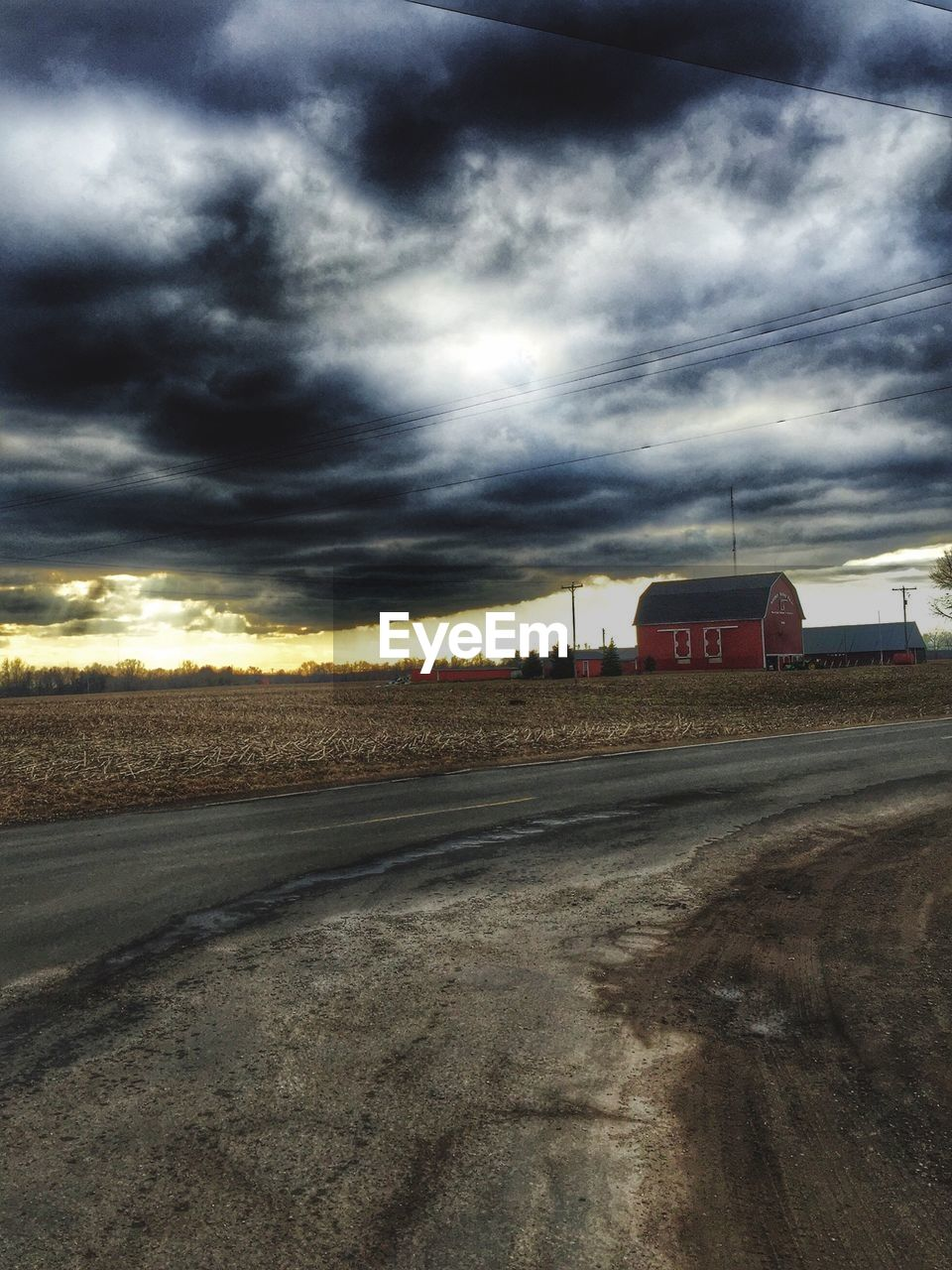 cloud - sky, sky, transportation, road, land vehicle, mode of transport, landscape, field, outdoors, sunset, no people, agriculture, nature, storm cloud, day