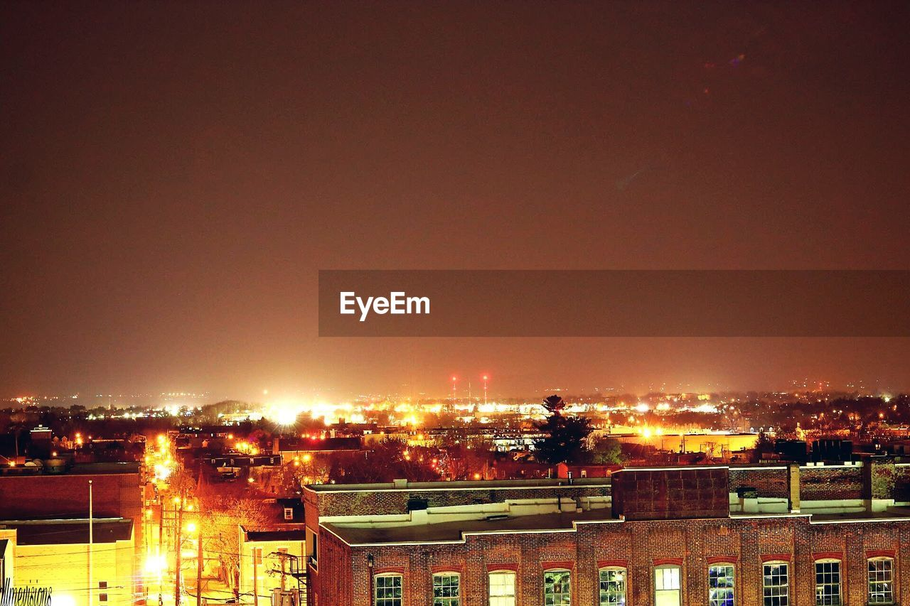 architecture, building exterior, built structure, cityscape, city, no people, illuminated, outdoors, residential building, sky, night, sunset, tree, nature, chain bridge