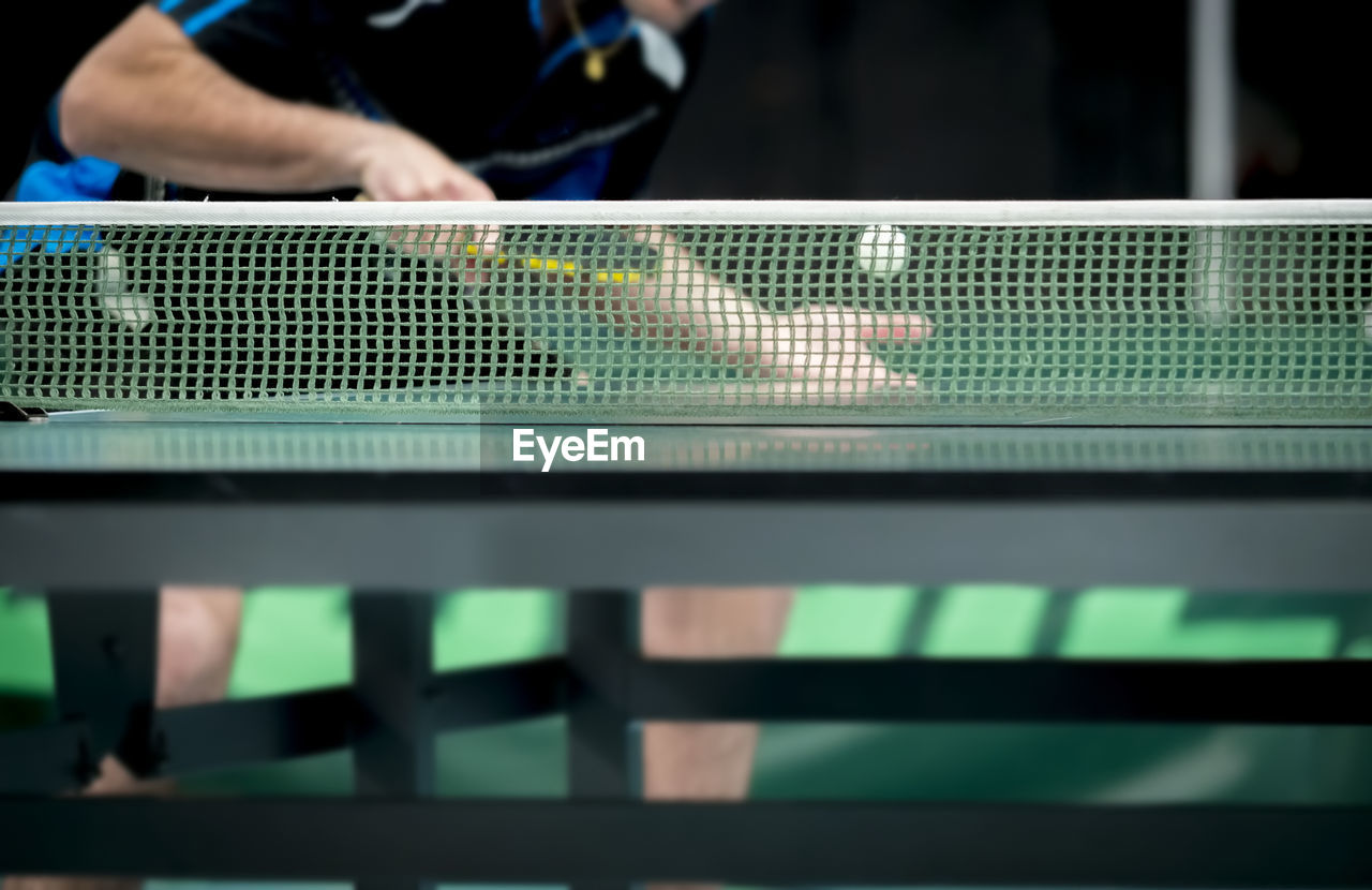 table tennis, real people, one person, indoors, table, sport, selective focus, midsection, unrecognizable person, day, human hand, focus on foreground, playing, ball, close-up, standing, leisure activity, holding, pool, swimming pool, finger