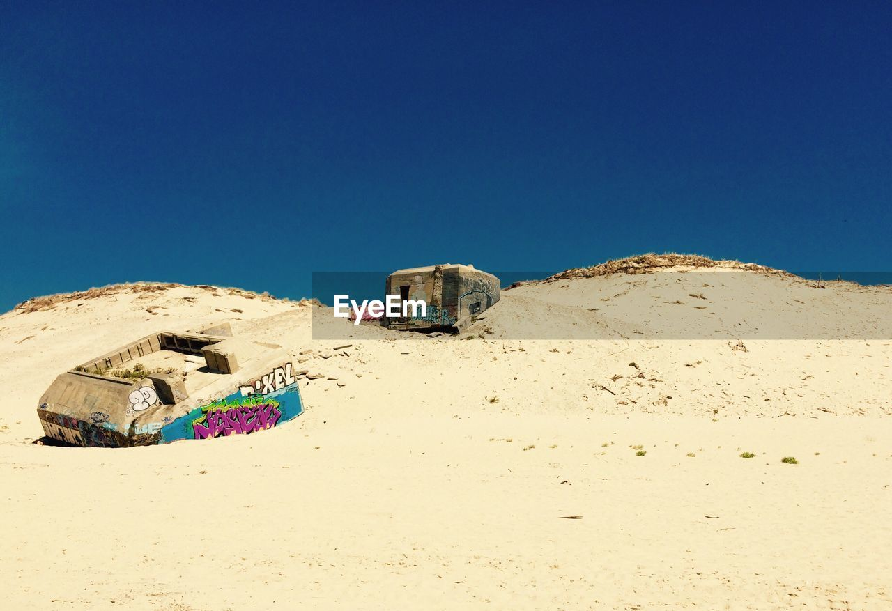copy space, clear sky, blue, sunlight, sand, no people, abandoned, arid climate, day, outdoors, desert, nature, sky