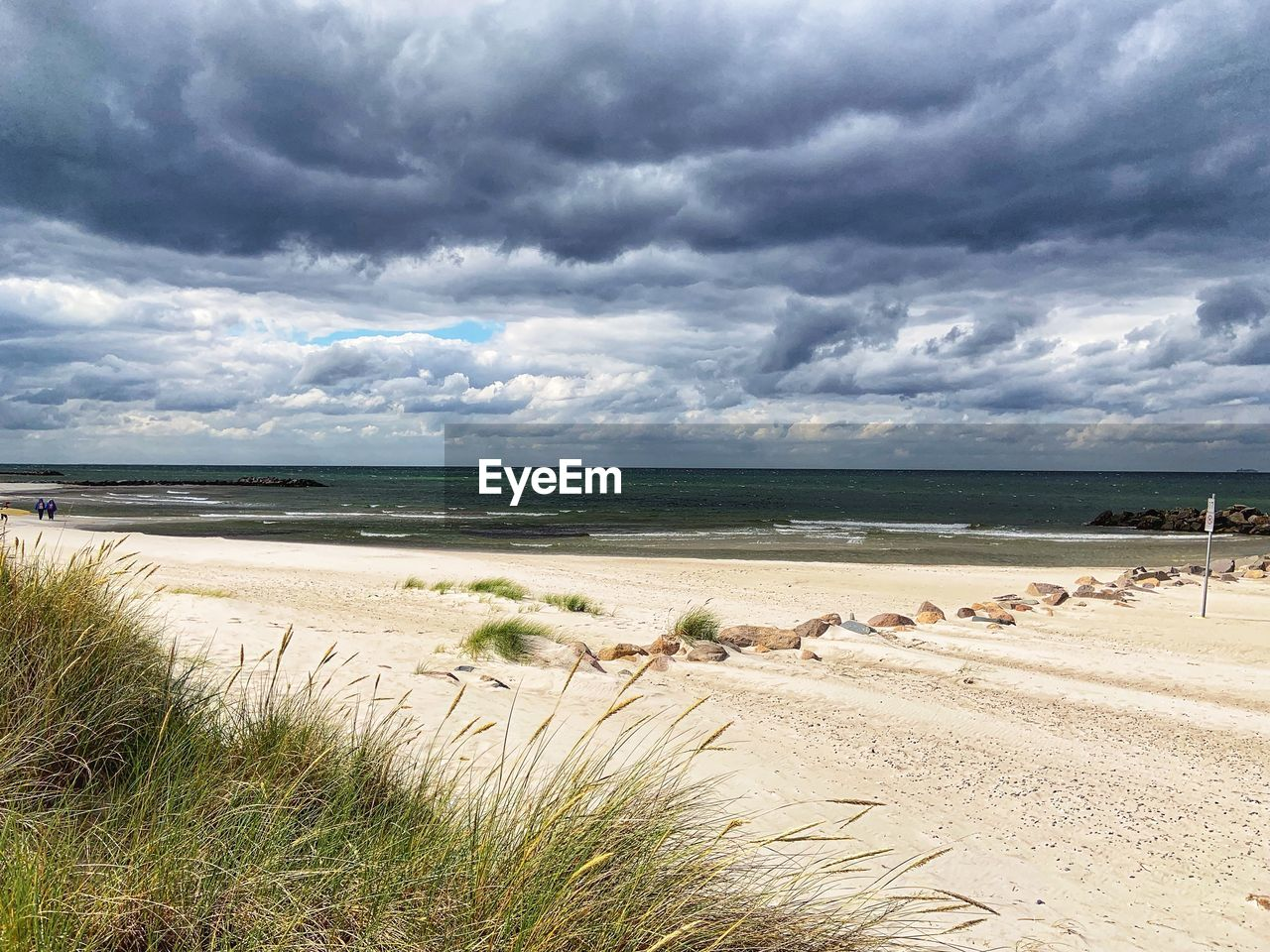cloud - sky, sky, land, water, beach, beauty in nature, sand, sea, scenics - nature, nature, tranquility, plant, tranquil scene, grass, day, no people, overcast, horizon over water, marram grass