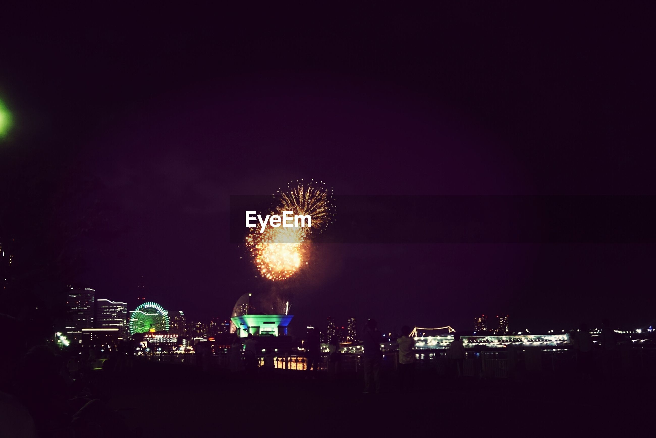 night, illuminated, glowing, long exposure, firework display, exploding, firework - man made object, celebration, sparks, motion, arts culture and entertainment, building exterior, sky, fire - natural phenomenon, clear sky, copy space, dark, firework, outdoors, built structure
