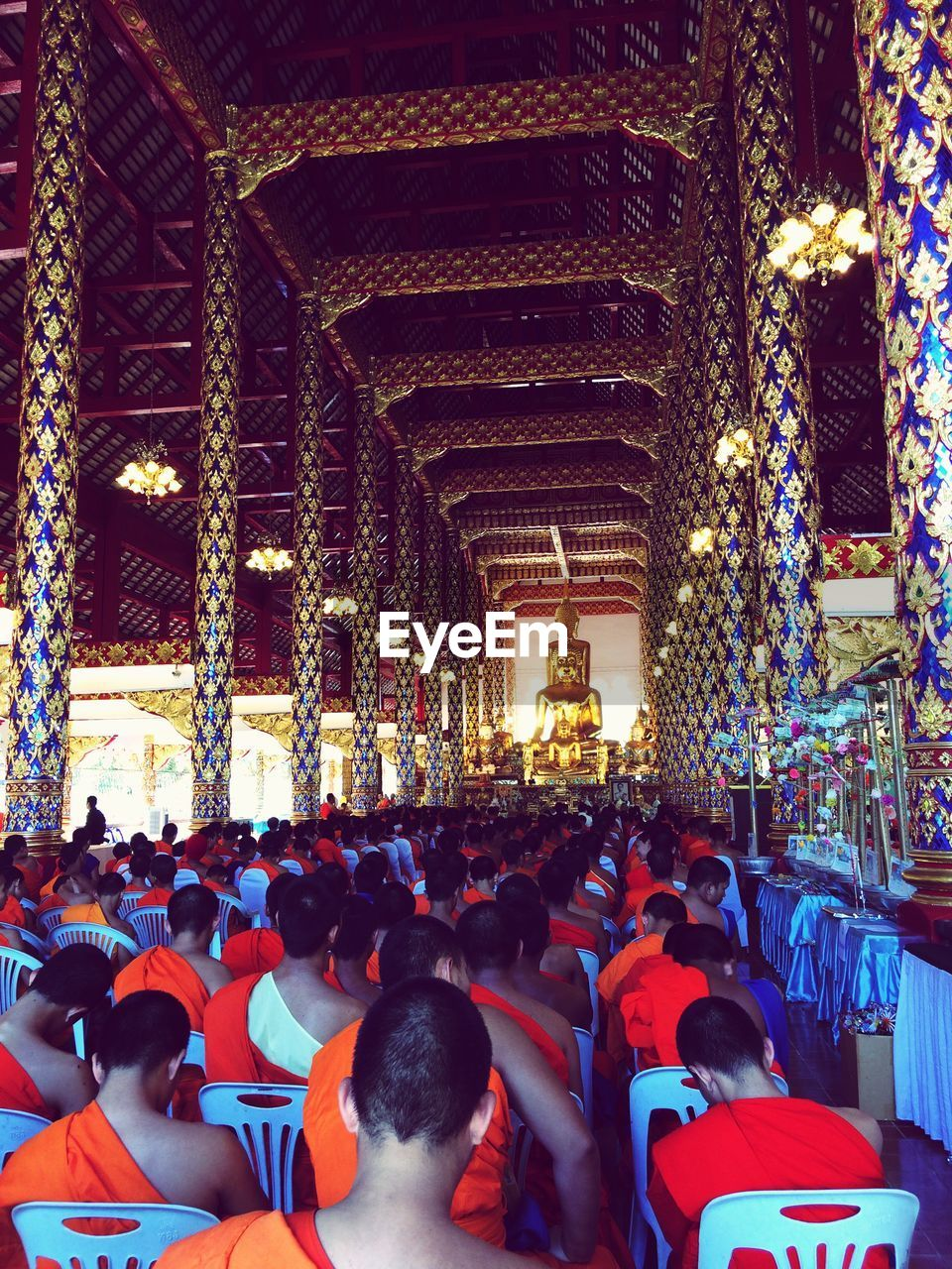 large group of people, real people, religion, architecture, built structure, men, place of worship, spirituality, women, indoors, leisure activity, crowd, lifestyles, illuminated, togetherness, building exterior, day, people