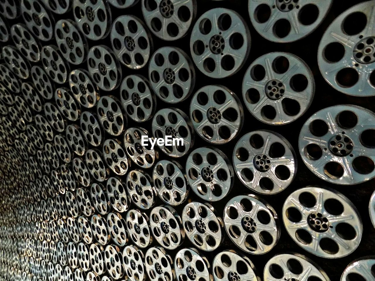 Detail Shot Of Film Reels Mounted On Wall