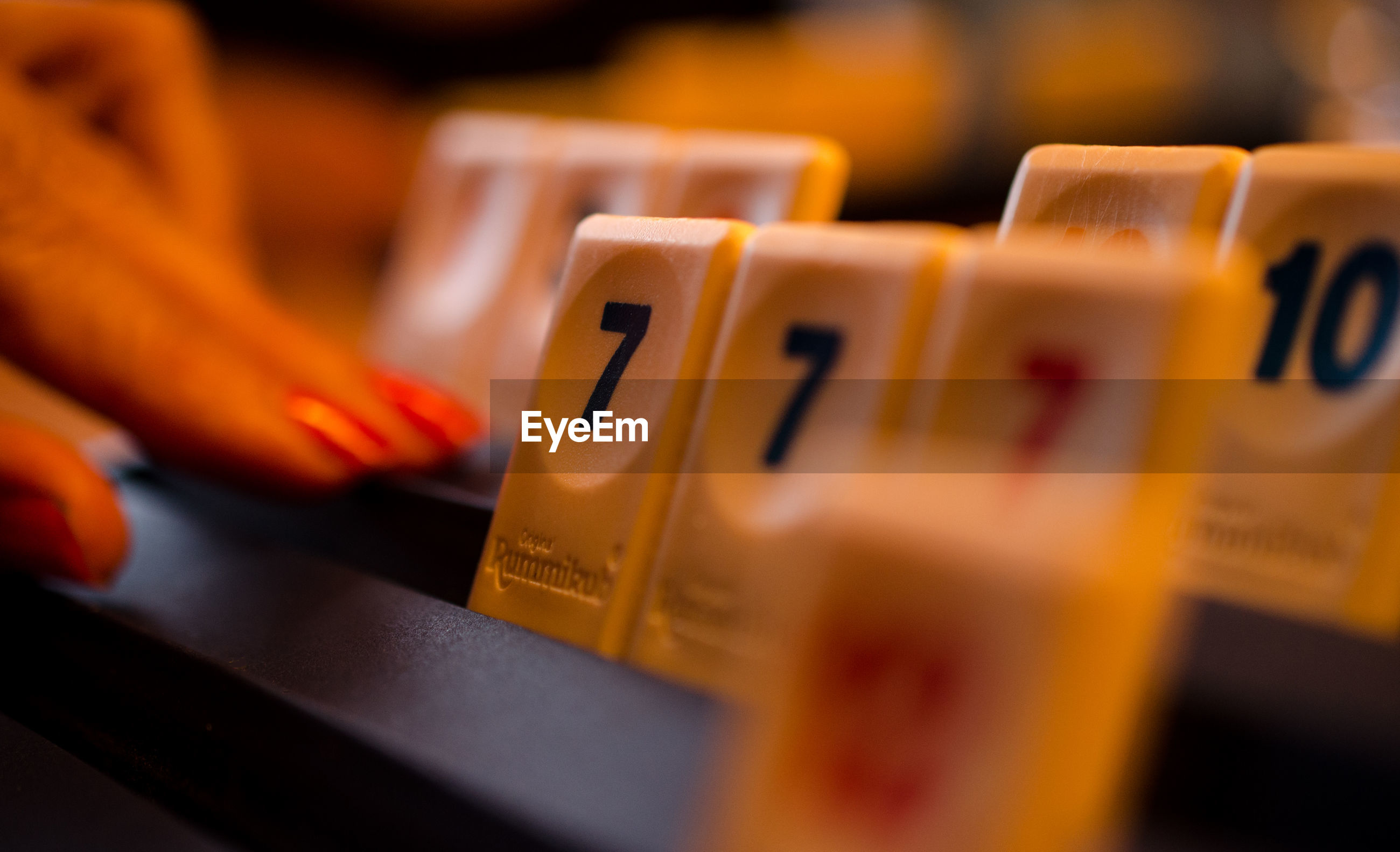 Cropped image of finger by rummikub