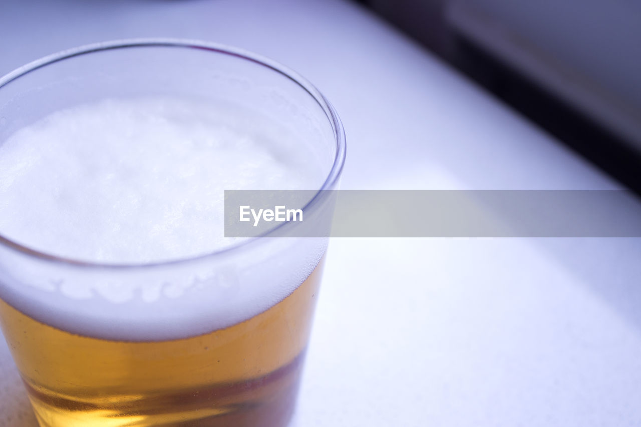 drink, food and drink, refreshment, glass, still life, drinking glass, indoors, table, household equipment, close-up, glass - material, freshness, beer - alcohol, beer, alcohol, no people, high angle view, food, frothy drink, healthy eating, beer glass, pint glass, froth, non-alcoholic beverage