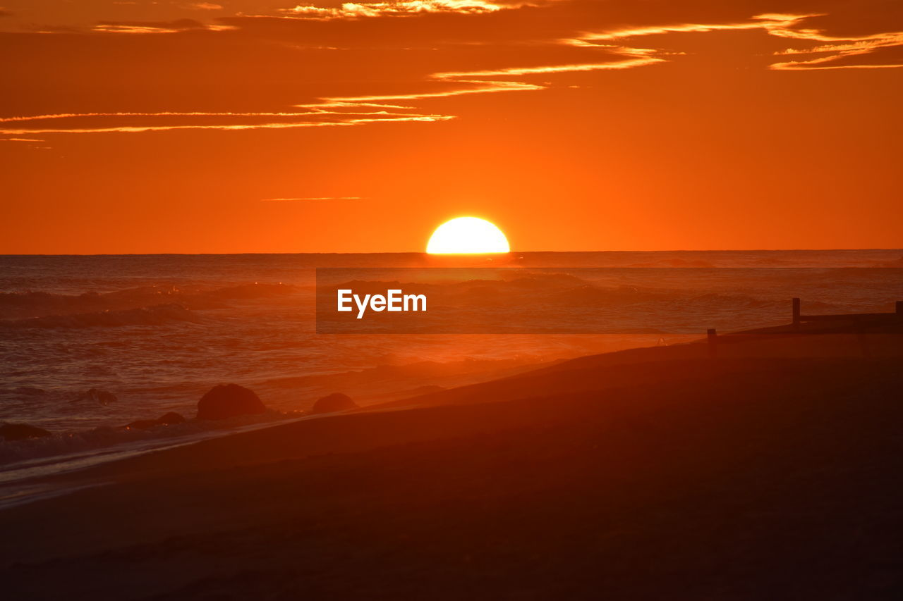 sunset, sea, sky, water, beauty in nature, scenics - nature, orange color, horizon over water, horizon, sun, tranquility, beach, tranquil scene, land, idyllic, nature, non-urban scene, sunlight, no people, outdoors, romantic sky