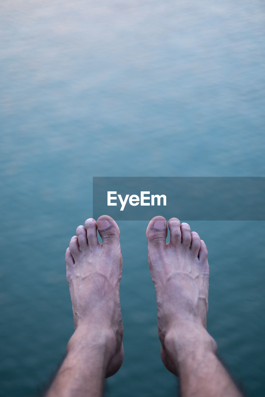 human body part, body part, one person, water, real people, barefoot, low section, human leg, personal perspective, lifestyles, leisure activity, sea, day, nature, human foot, relaxation, blue, outdoors, human limb