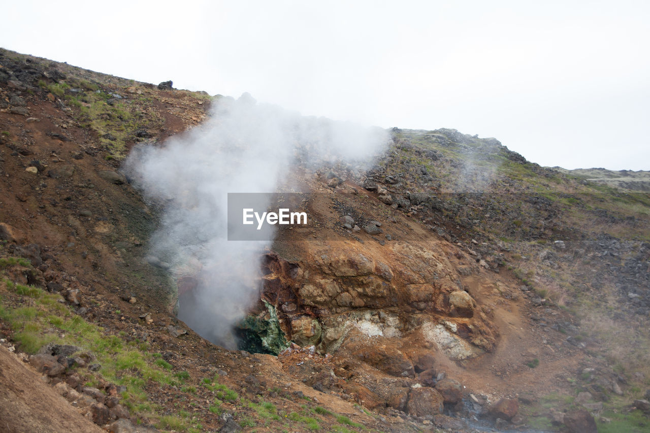 nature, smoke - physical structure, geology, landscape, day, outdoors, beauty in nature, no people, scenics, tranquility, sky, mountain