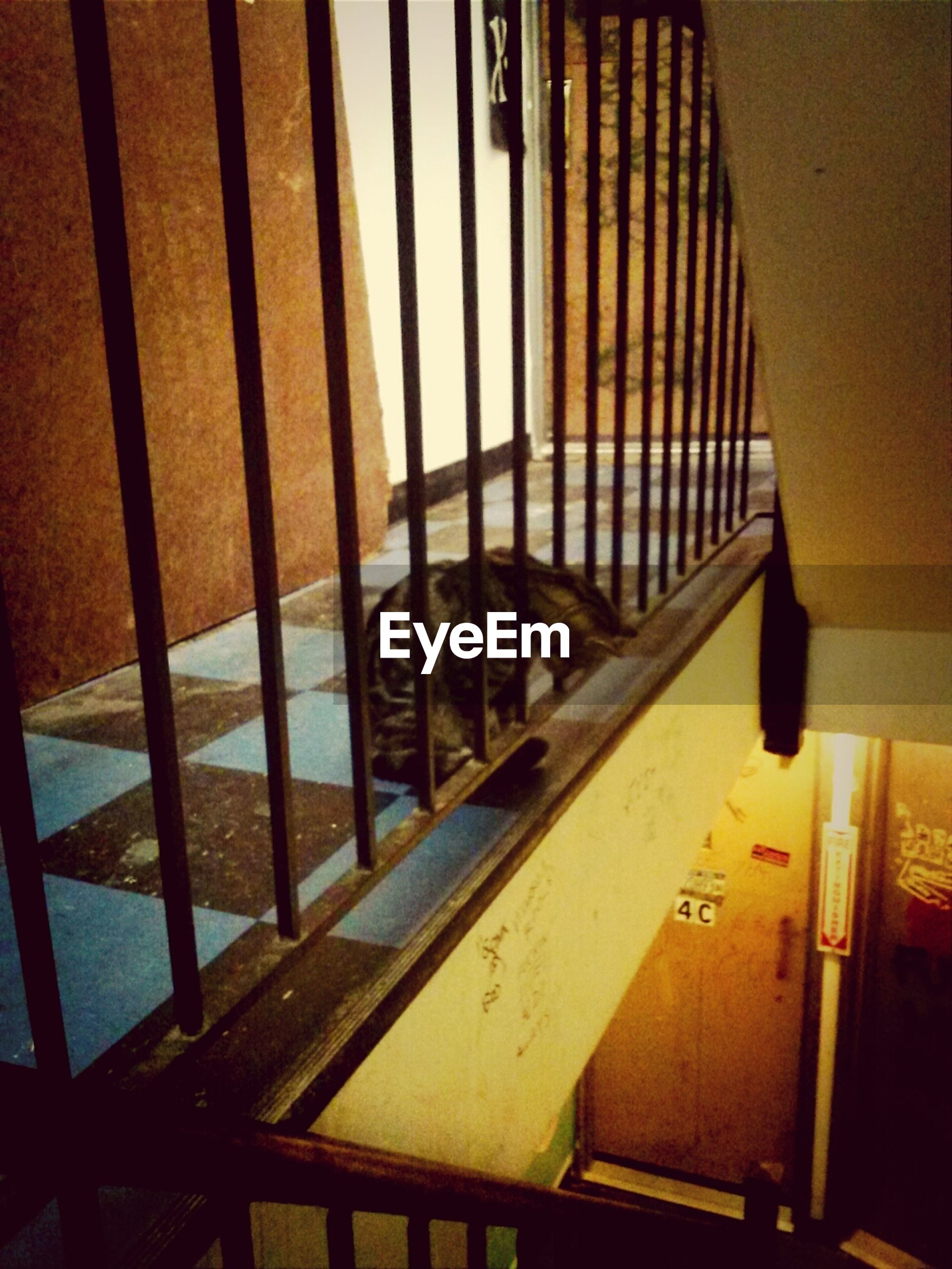 indoors, railing, architecture, built structure, high angle view, no people, yellow, metal, pattern, window, sunlight, steps, close-up, shadow, day, staircase, wall - building feature, wood - material, empty, steps and staircases