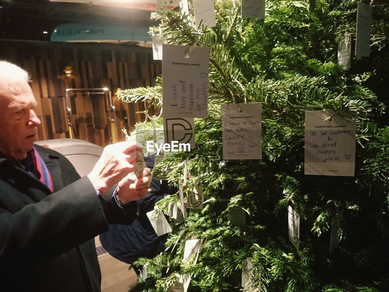 text, plant, one person, real people, communication, food and drink, day, outdoors, paper, freshness, food, human hand, tree, architecture, nature, people