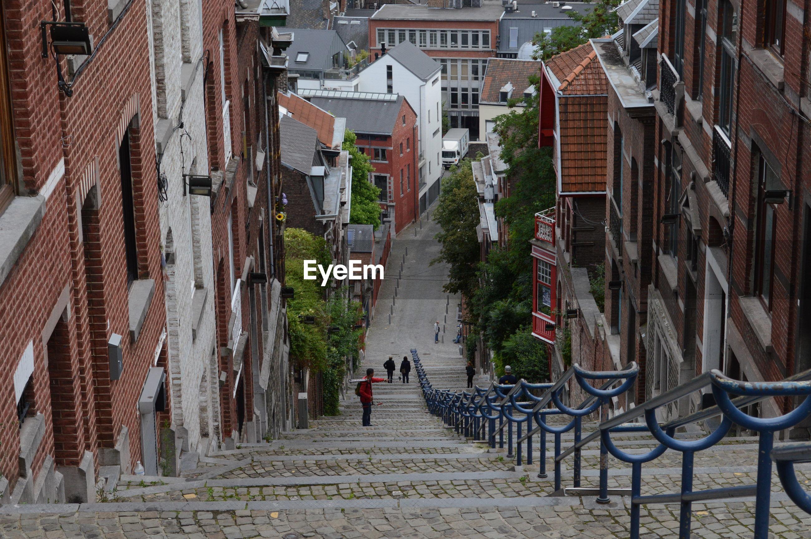 NARROW WALKWAY LEADING TOWARDS CITY