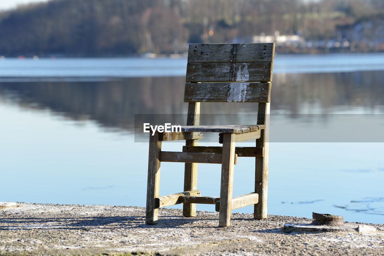 water, lake, wood - material, nature, day, focus on foreground, no people, tranquility, sunlight, tranquil scene, scenics - nature, reflection, outdoors, non-urban scene, beauty in nature, beach, lakeshore, seat, pier, wooden post