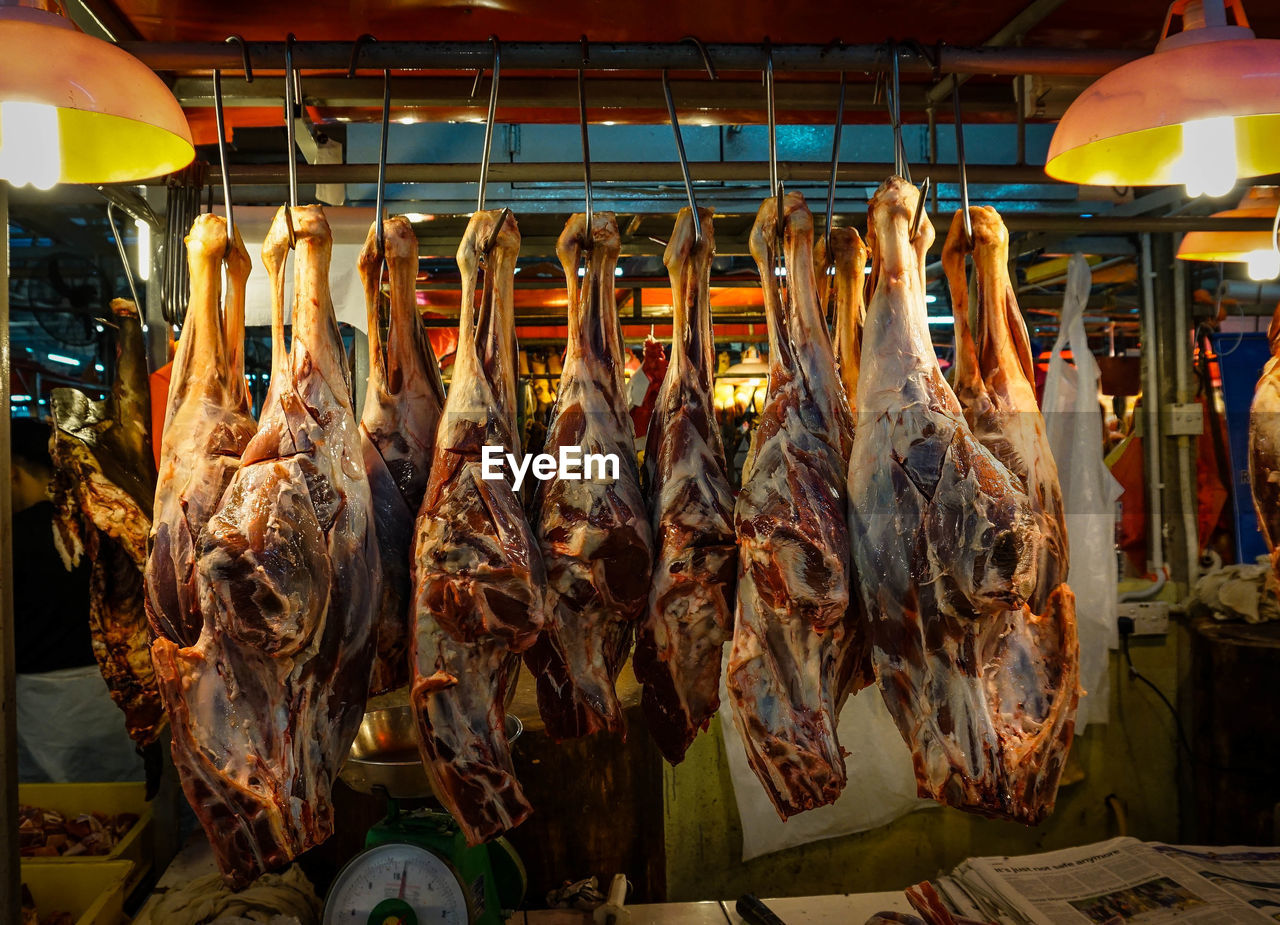 Raw meat hanging for sale at market
