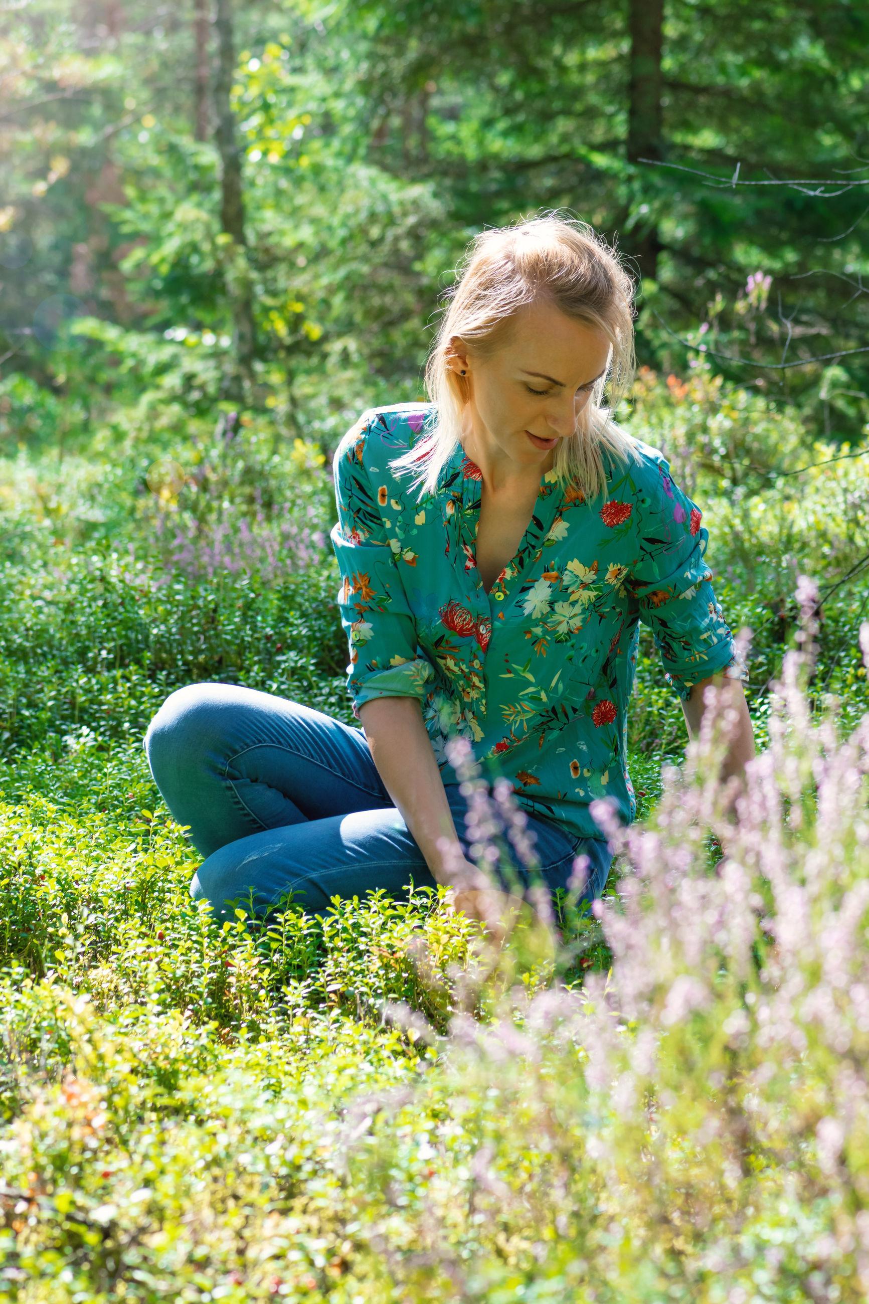Woman sitting amidst plants