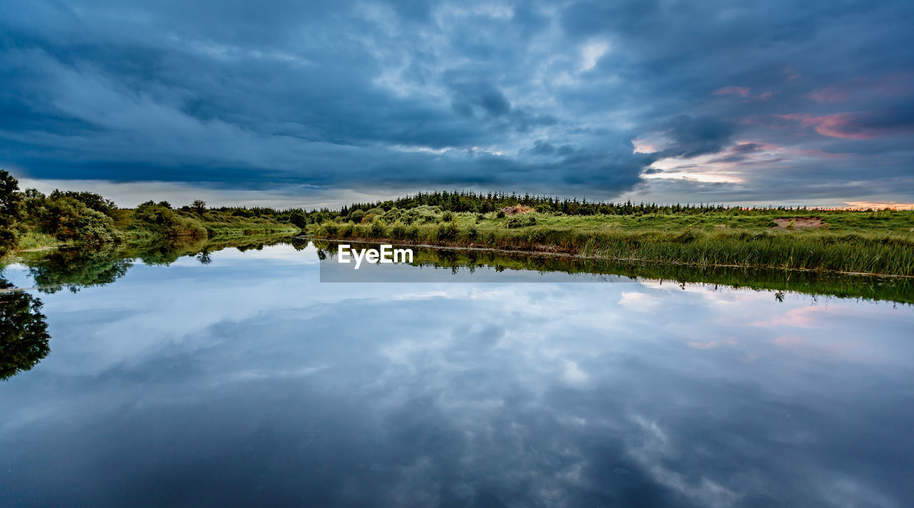 cloud - sky, sky, reflection, nature, water, tranquility, tranquil scene, beauty in nature, scenics, no people, outdoors, waterfront, lake, tree, day