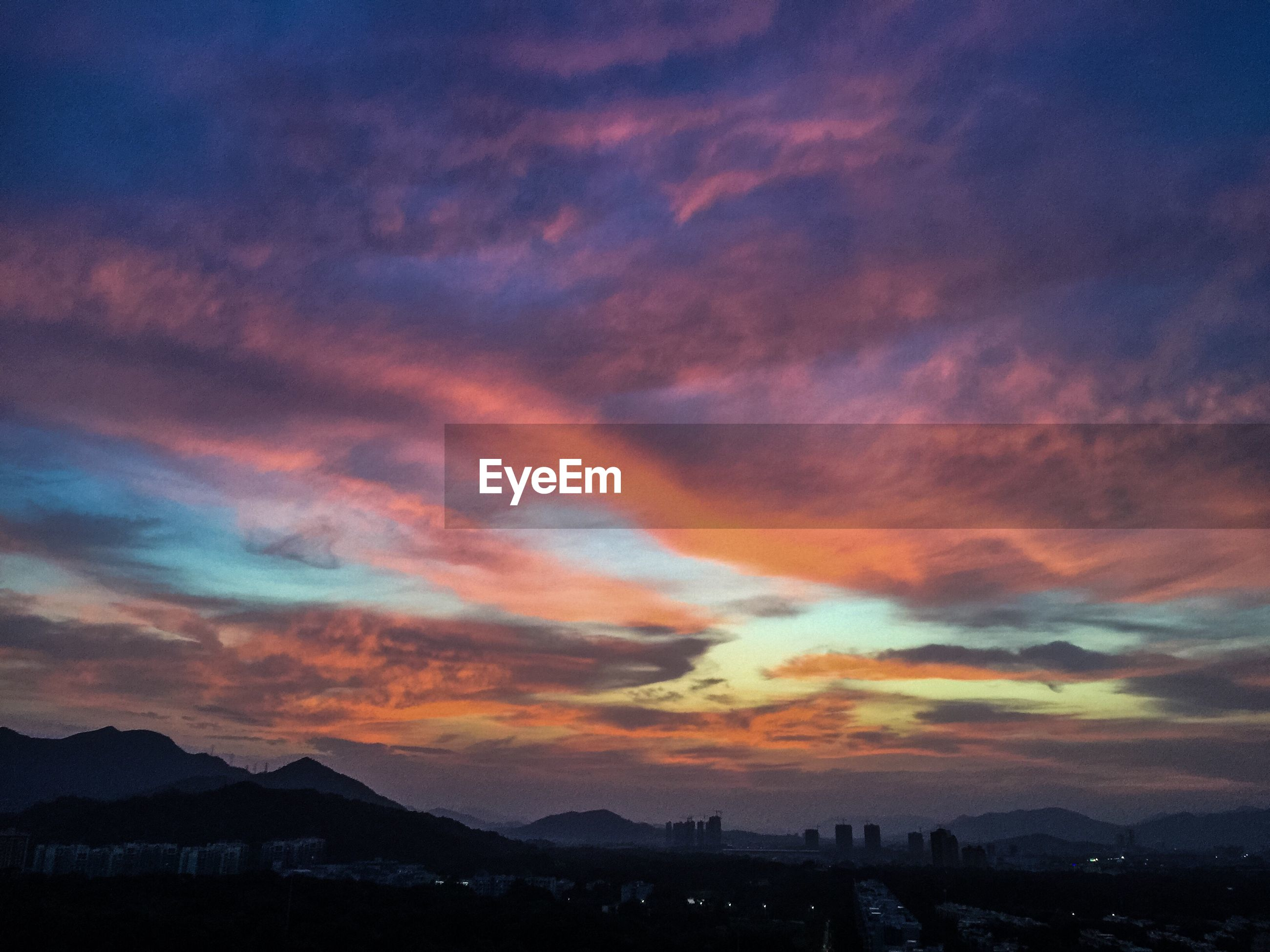 SILHOUETTE OF MOUNTAIN AGAINST SKY DURING SUNSET