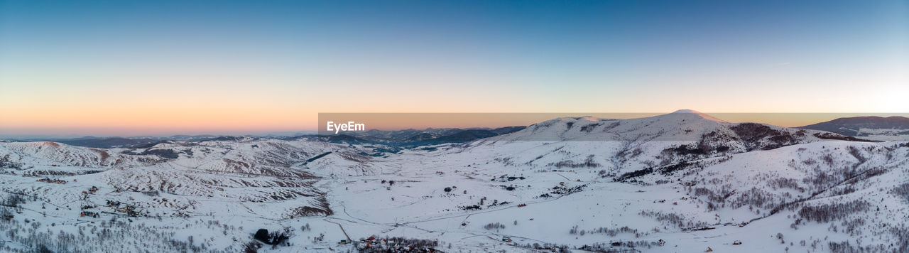 mountain, snow, scenics - nature, cold temperature, winter, beauty in nature, sky, tranquil scene, tranquility, environment, landscape, mountain range, sunset, non-urban scene, snowcapped mountain, nature, idyllic, clear sky, no people, mountain peak