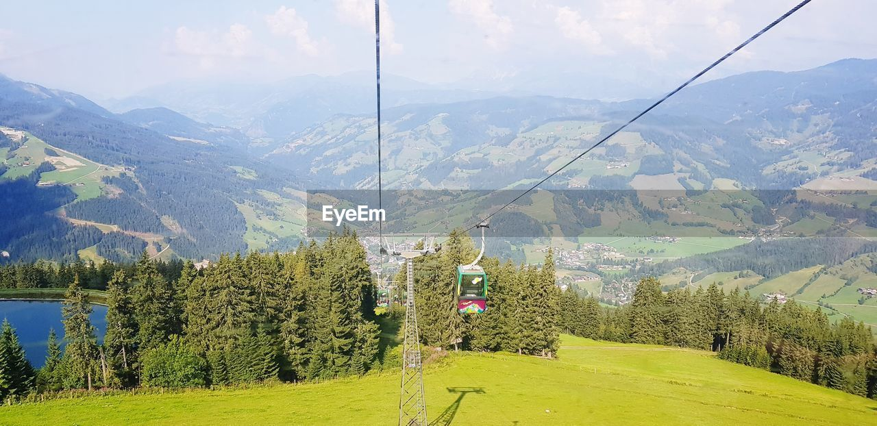 mountain, tree, scenics - nature, beauty in nature, plant, green color, landscape, mountain range, nature, tranquil scene, environment, cable car, non-urban scene, day, idyllic, overhead cable car, growth, tranquility, no people, cable, outdoors