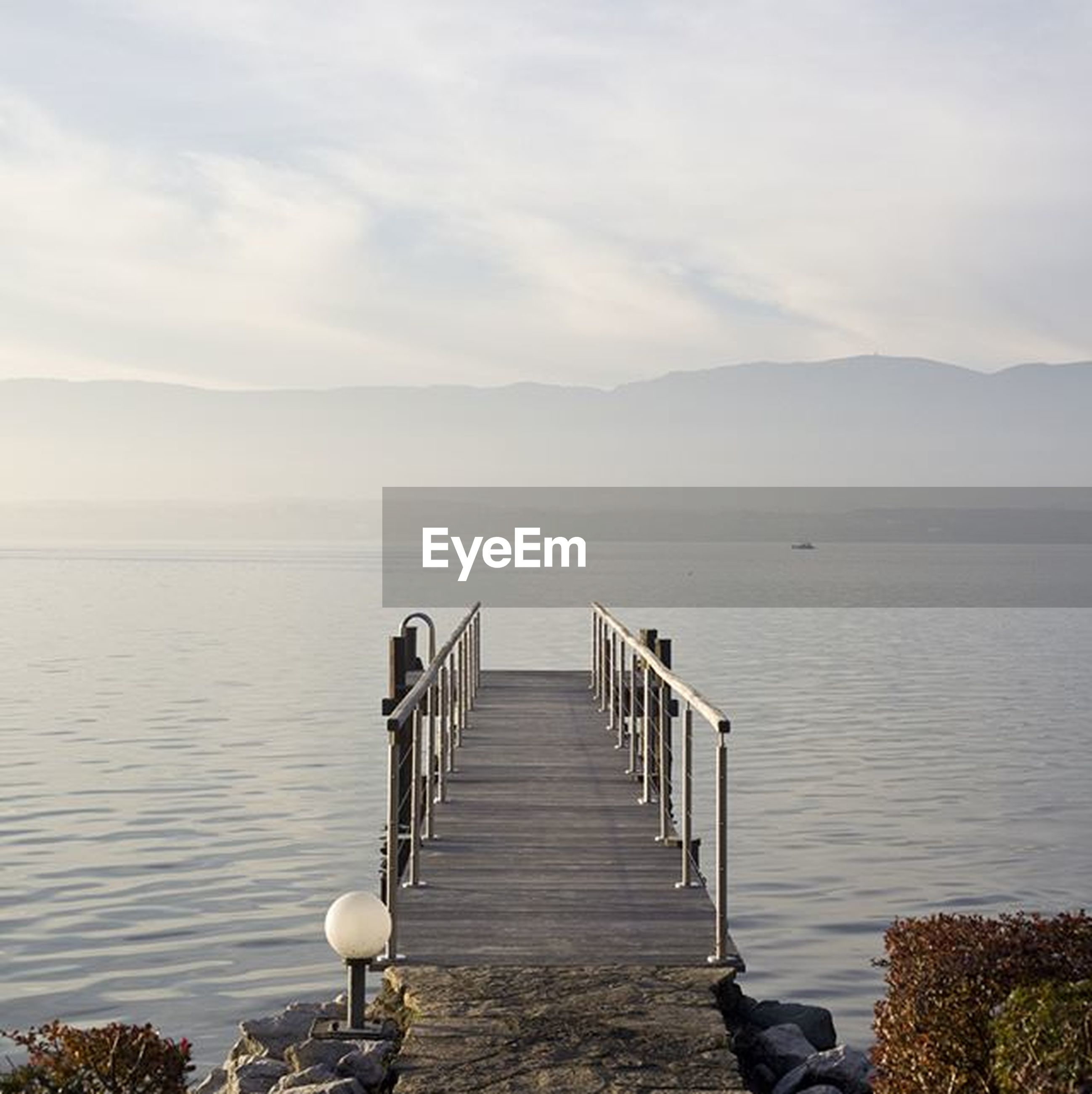 water, tranquil scene, tranquility, pier, sky, scenics, mountain, sea, wood - material, jetty, beauty in nature, lake, nature, railing, the way forward, wood, idyllic, empty, non-urban scene, day