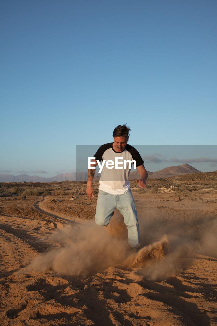 Full length of man running at desert