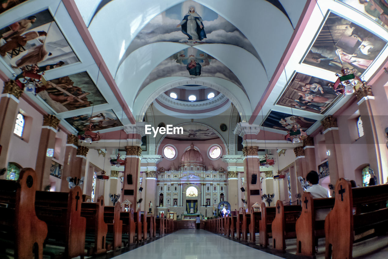 ceiling, architecture, indoors, religion, place of worship, built structure, hanging, illuminated, no people, day