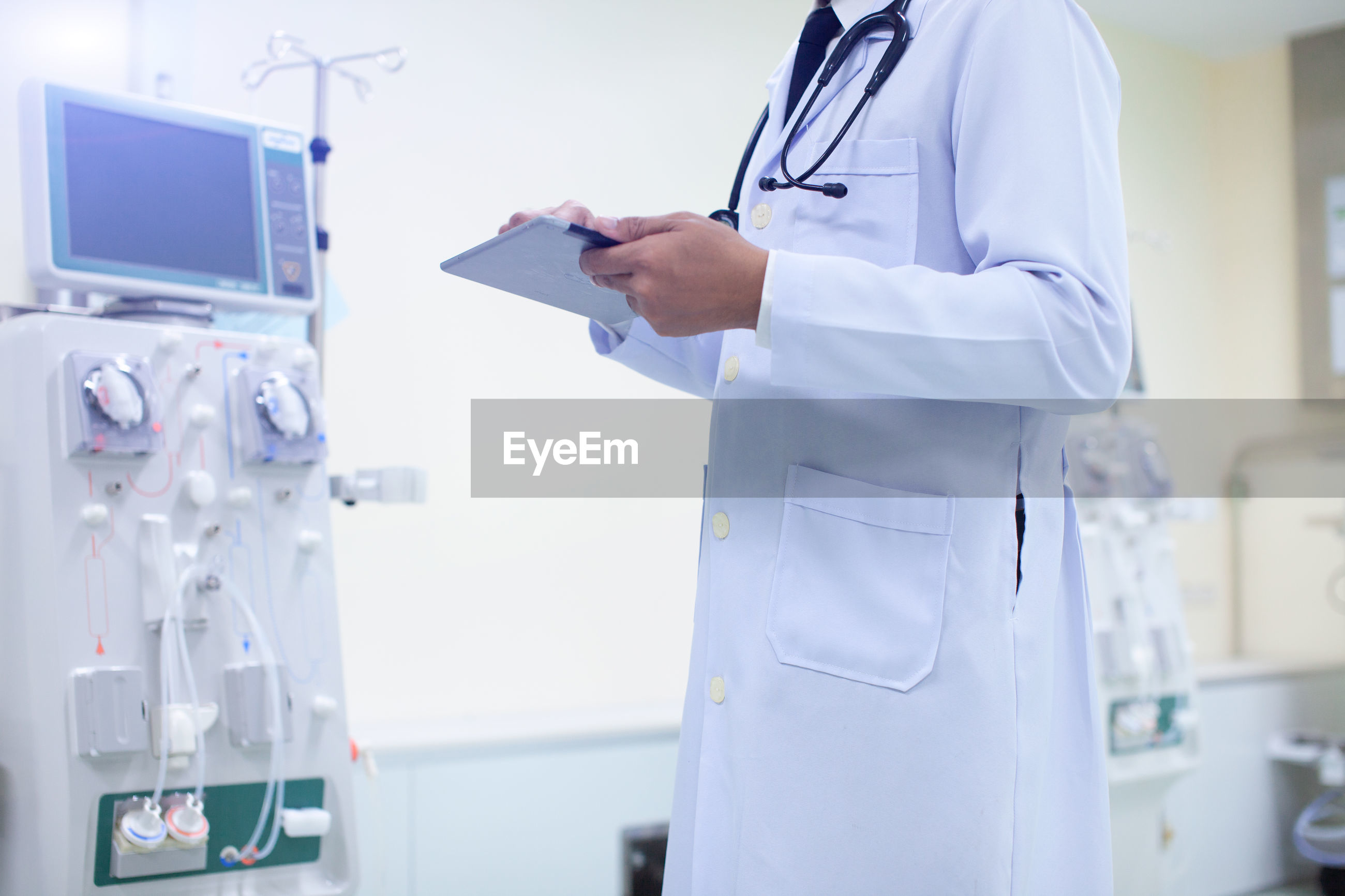 Midsection of doctor working in hospital