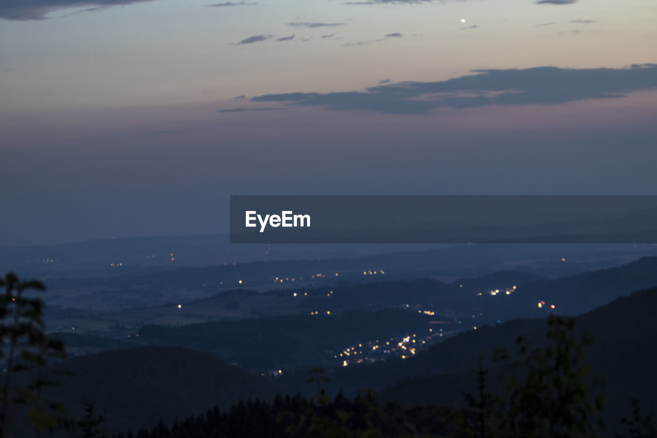 SCENIC VIEW OF LANDSCAPE AGAINST SKY AT DUSK