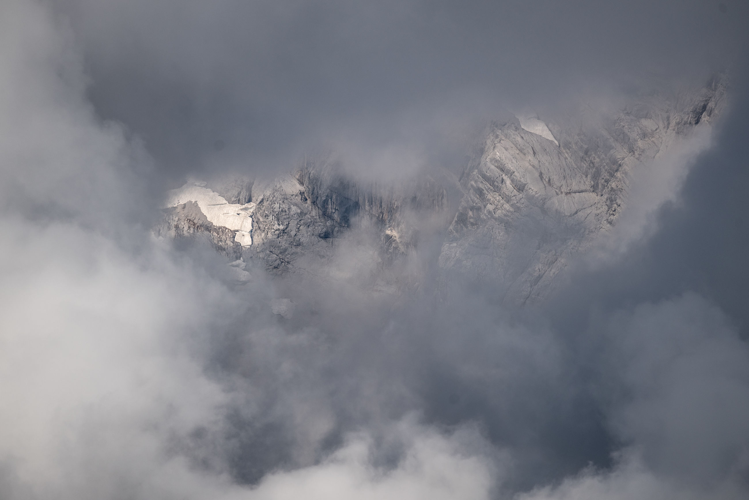 LOW ANGLE VIEW OF MAJESTIC SNOWCAPPED MOUNTAIN AGAINST SKY
