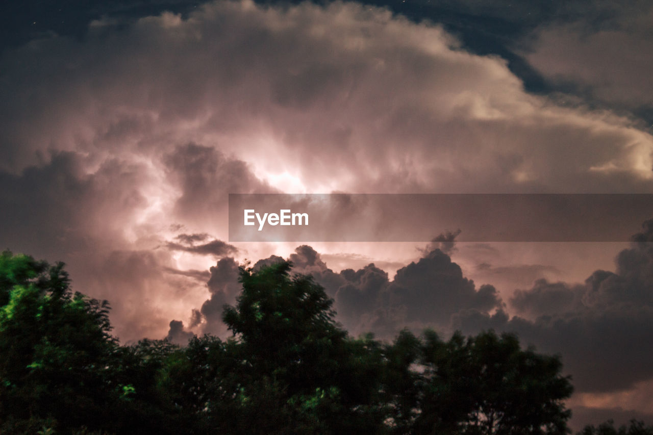 cloud - sky, sky, beauty in nature, scenics - nature, tranquility, tree, tranquil scene, low angle view, plant, no people, nature, sunset, dramatic sky, idyllic, non-urban scene, silhouette, outdoors, storm, overcast, ominous, meteorology