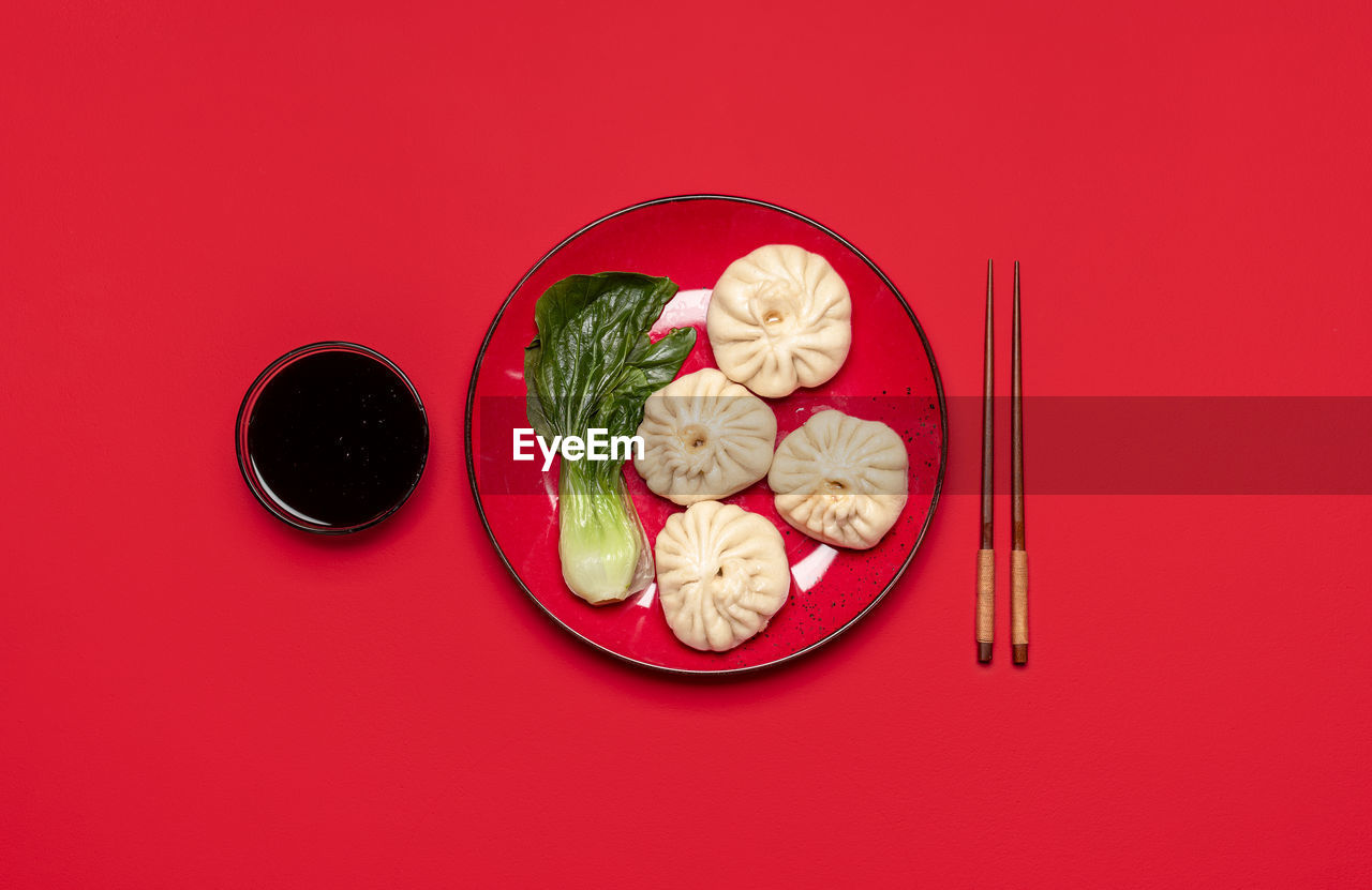 HIGH ANGLE VIEW OF FOOD ON RED TABLE