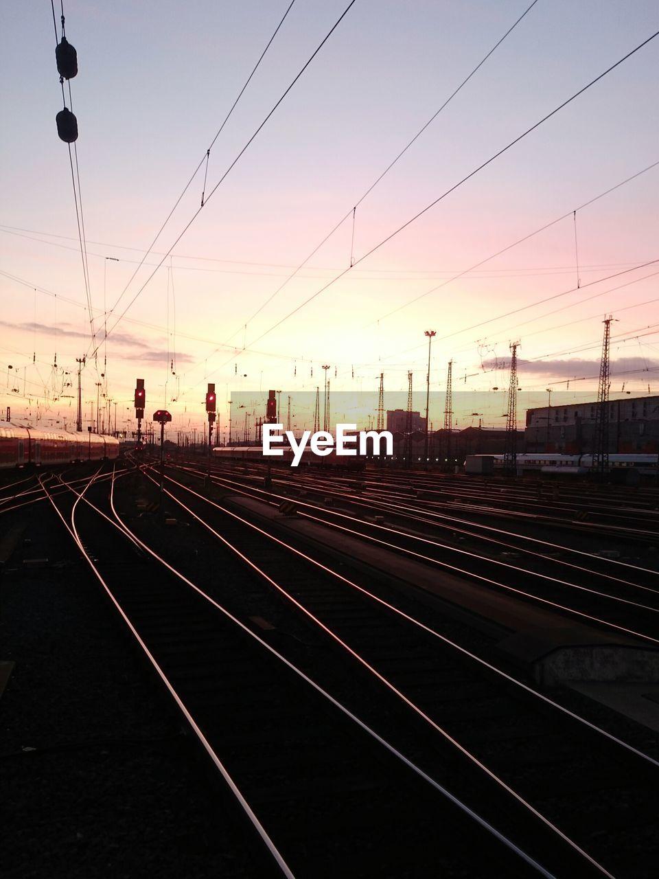 Surface level of railway tracks at sunset